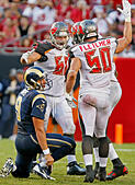 Sept. 14, 2014 - Tampa, Florida, U.S. - JIM DAMASKE | Times.Bucs Scott Solomon (60) and Dane Fletcher (50) celebrate William Gholston's (92) sack of Rams qtr back Austin Davis (9) during the Tampa Bay Buccaneers game against the Rams at Raymond James Stadium on Sunday afternoon 9/14/14. (Credit Image: © Jim Damaske/Tampa Bay Times/ZUMA Wire) -Stock Image- E7H1H6