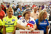 July 10, 2014 - City, Florida, U.S. - OCTAVIO JONES | Times .(From left) Ty Hill sits with his wife Kathy Hill and Natalie Kahler, a candidate for Brooksville City Council all listen to candidates running for office, give their 5-minute campaign speech at the Knights of Columbus building in Spring Hill on Thursday. The Greater Hernando County Chamber of Commerce sponsored the ''Politics in the Park'' meet-and-greet the 2014 candidates forum held at the Knights of Columbus in Spring Hill on Thursday, July 7, 2014. Residents of Hernando County had the opportunity before the primary elections -Stock Image- E58TA5