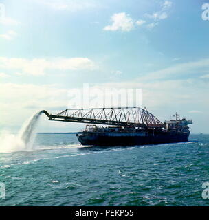 AJAXNETPHOTO. 1966. LAKE MARACAIBO, VENEZUELA. - CLEAN SWEEP - THE HUGE 15,000 TON DREDGER ZULIA AT WORK AT THE ENTRANCE TO LAKE MARACAIBO, VENEZUELA. BUILT IN JAPAN 1959; WORLD'S LARGEST ARM DREDGER AT THE TIME. PHOTO:JONATHAN EASTLAND/AJAX. REF:56612_6