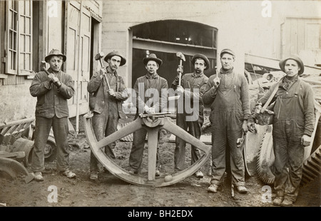 Six Laborers & Half of Giant Industrial Wheel