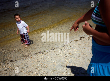 "KERI WIGINTON   |   Times PT_320980_WIGI_hudson_3 (04/05/2010 Hudson) Carolyn Dragseth of Wesley Chapel tells her son Raymond, 2, to stay out of the water at Robert Strickland Beach, or Hudson Beach, on Monday, April 5, 2010. ""We decided to try Pasco beaches,"" said Dragseth, who usually drives down"