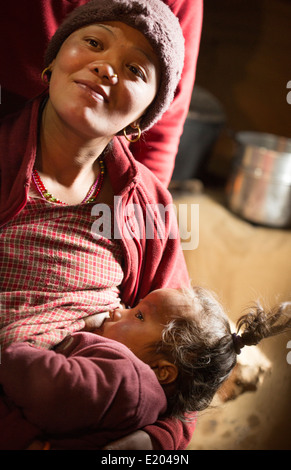 Nepal Sherpa woman breast feeds her child in their home in Namche Bazarre remote, Mt Everest 79
