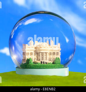 A Snow Globe Snow Dome Glass Bubble with the Washington DC White House. Concept safety security protection isolation disconnect