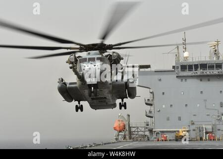 GULF OF ADEN (July 2, 2019) A CH-53E Super Stallion with the 11th Marine Expeditionary Unit (MEU) takes off during flight operations aboard USS Lewis B. Puller (ESB 3). The expeditionary sea base platform supports Naval Amphibious Force, Task Force 51/5th Marine Expeditionary Brigade's diverse missions that include crisis response, airborne mine countermeasures, counter-piracy operations, maritime security operations and humanitarian aid/disaster relief missions while enabling TF 51/5 to extend its expeditionary presence in the world's most volatile regions. (U.S. Navy photo by Seaman Jamesha