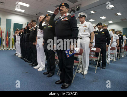 180301-N-XP344-012 MANAMA, Bahrain (March 1, 2018) Service members salute during the Kingdom of Bahrain's national anthem in the multipurpose room aboard Naval Support Activity Bahrain during Combined Maritime Forces' Combined Task Force (CTF) 151's change of command ceremony. CTF 151's area of operation includes some of the world's busiest shipping lanes and spans over two million square miles, covering the Red Sea, Gulf of Aden, Indian Ocean and Gulf of Oman. (U.S. Navy photo by Mass Communication Specialist 2nd Class Victoria Kinney/Released)