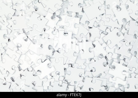 Pile of White Blank Puzzle Pieces Background.
