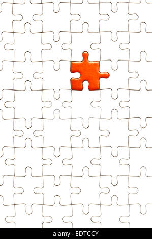 white jigsaw puzzle with one piece red