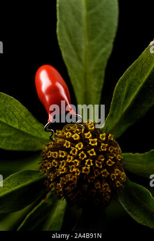 Electronic insect feeds on a flower