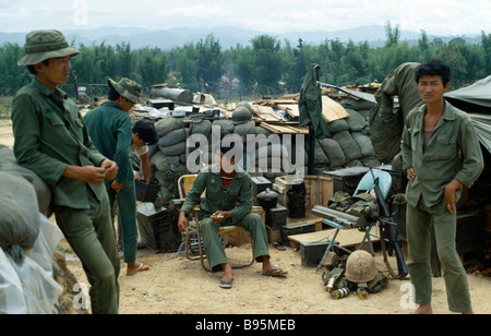 Vietnam War Central Highlands Siege of Kontum Montagnard soldiers gathered in base within a barbed wire perimeter