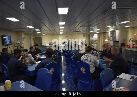GULF OF ADEN (Sept. 22, 2018) Morale Welfare and Recreation hosts a spades tournament as one of many events aboard USS Lewis B. Puller (ESB 3). The expeditionary sea base platform supports Naval Amphibious Force, Task Force 51, 5th Marine Expeditionary Brigade's diverse missions that include crisis response, airborne mine countermeasures, counter-piracy operations, maritime security operations and humanitarian aid/disaster relief missions while enabling TF 51/5 to extend its expeditionary presence in the world's most volatile regions.