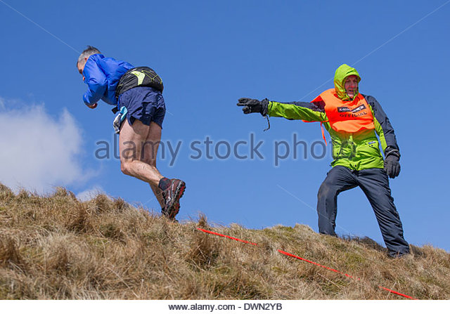 a-runner-is-directed-to-the-whernside-su