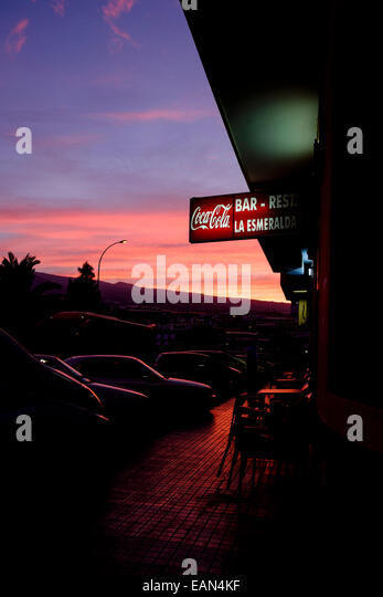 red-sky-at-dawn-with-coca-cola-sign-on-t
