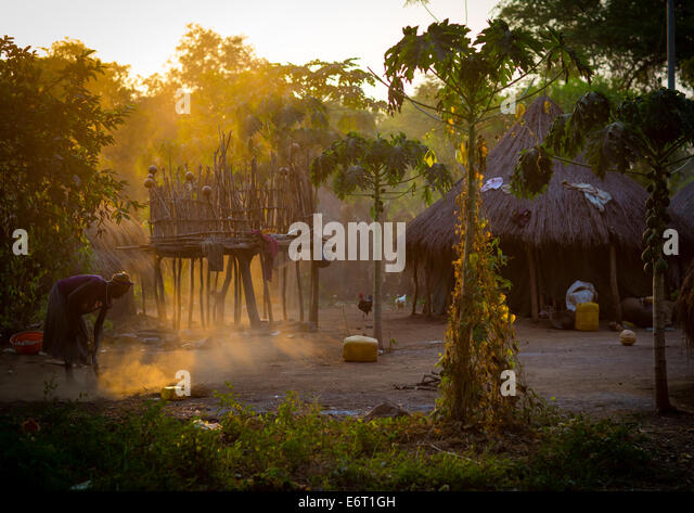 anuak-tribe-woman-cleaning-the-ground-in