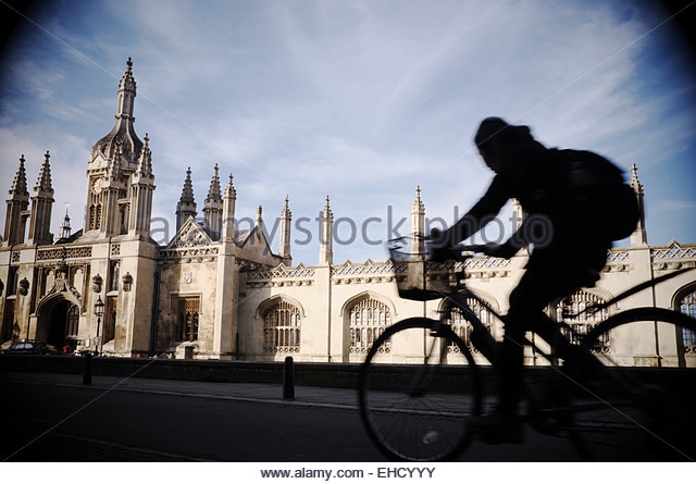 a-cyclist-travels-along-kings-parade-wit
