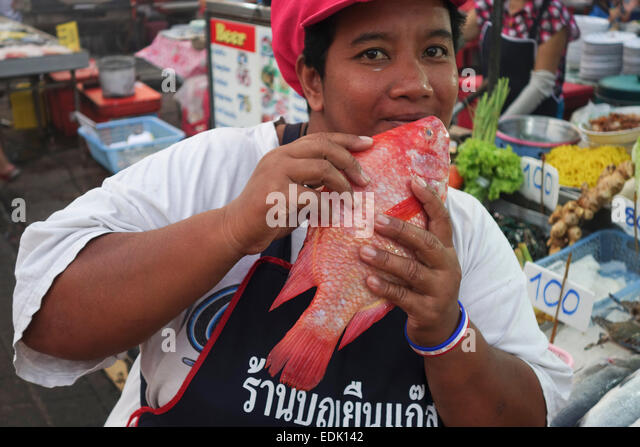 vendor-with-fresh-red-snapper-at-night-m