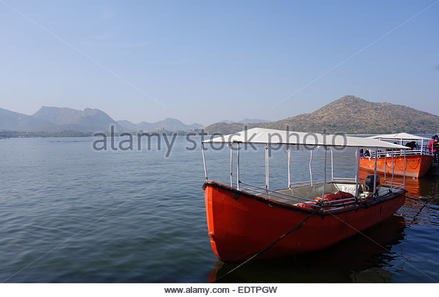 two-red-boats-docked-for-boat-ride-on-fa