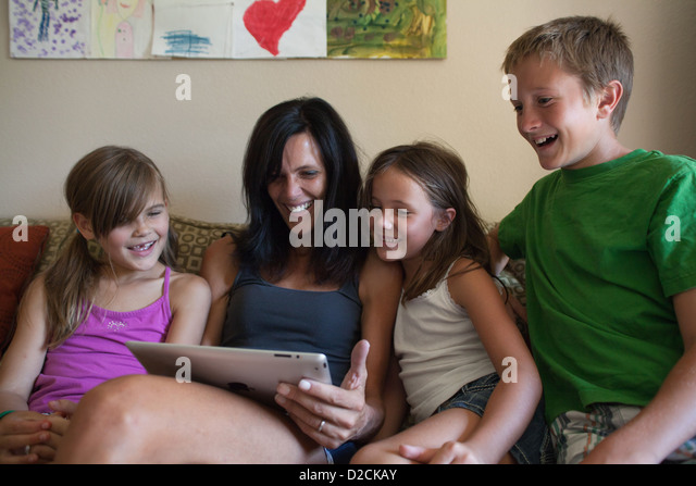 mother-and-her-three-kids-looking-at-an-
