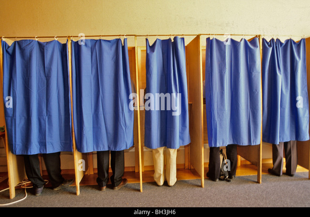 voters-vote-in-a-voting-booth-at-a-polli