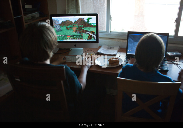 two-boys-playing-the-video-game-minecraf