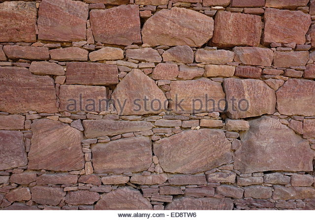 wall-made-of-interlocking-dry-stones-wit