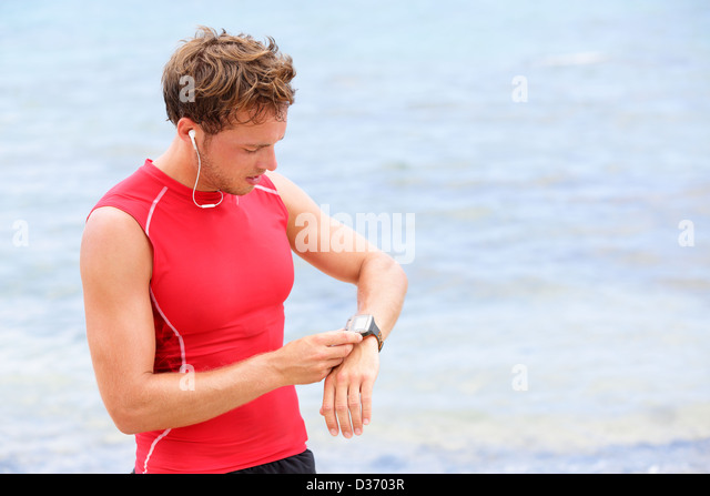 athlete-runner-looking-at-heart-rate-mon