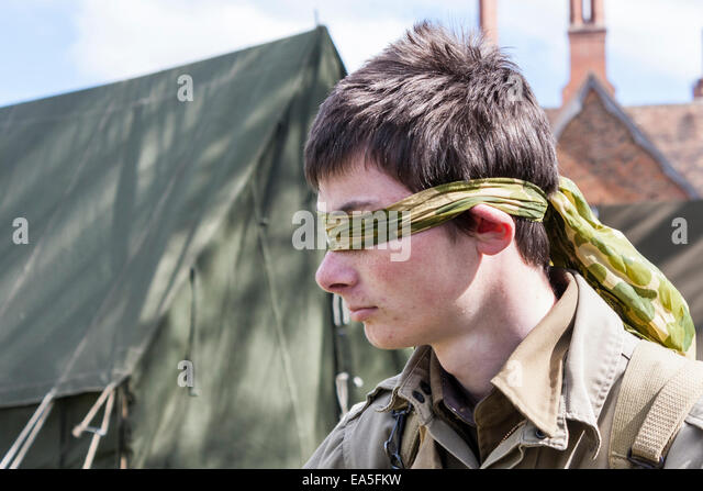 blindfolded-youth-in-wwii-us-army-unifor