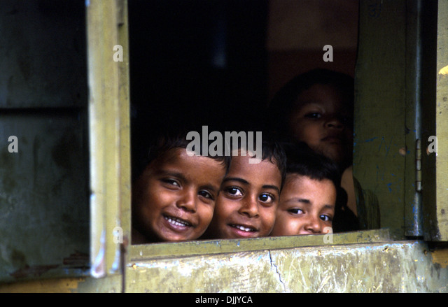 three-boys-and-a-girl-observing-behind-a