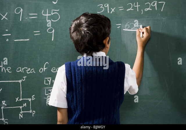 rear-view-of-boy-at-chalkboard-doing-mat