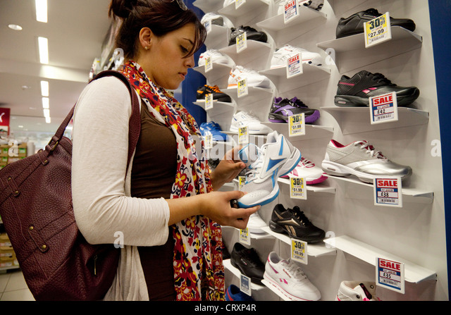 young-woman-shopping-for-trainers-in-spo