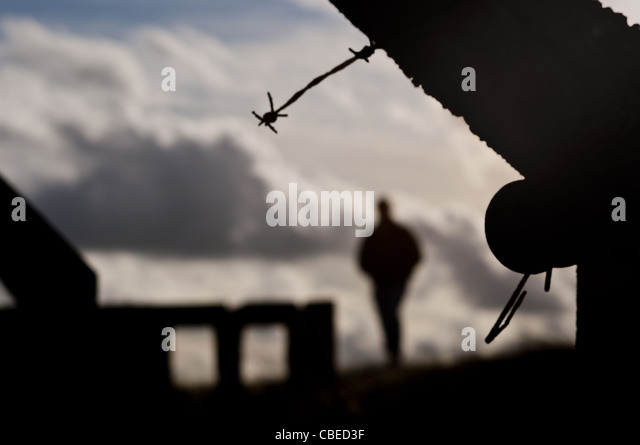 barbed-wire-fence-with-figure-of-man-cbe