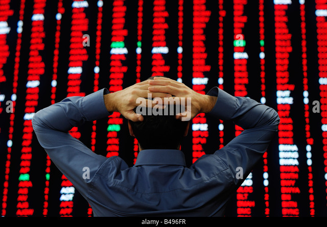 stock-trader-stood-in-front-of-a-large-d