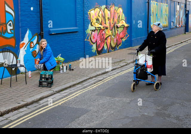 elderly-lady-asking-a-young-female-stree