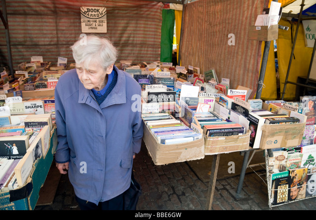 an-old-lady-at-a-second-hand-books-cambr