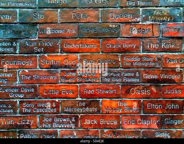 musical-groups-carved-in-bricks-outside-