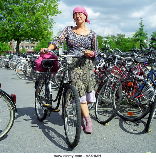 lady-with-her-bicycle-in-braunschweig-ge