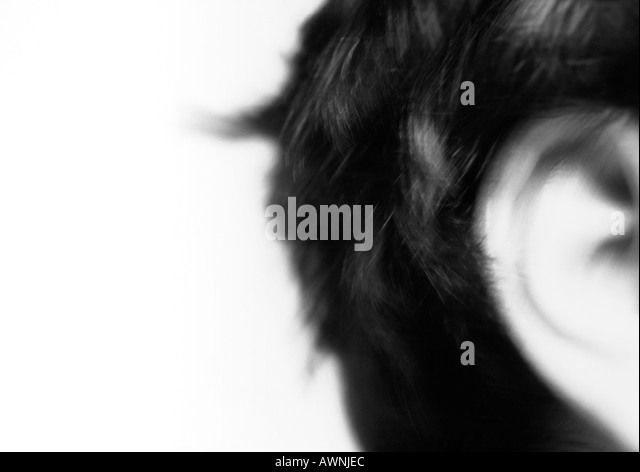 mans-ear-close-up-blurred-black-and-whit