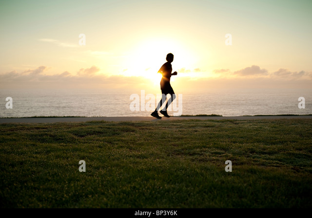 a-silhouette-of-a-jogger-running-alone-w