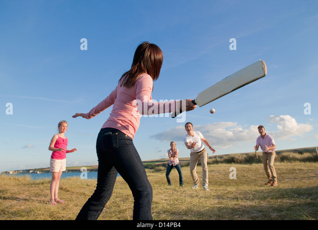 family-playing-cricket-together-outdoors