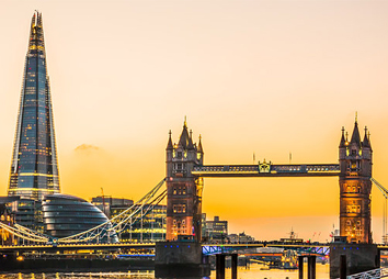 The new London skyline with Tower Bridge and the new The Shard skyscraper at Dusk. - Stock Photo