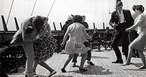 boat party couples dance and jive in true 60 s style Couple kissing doing the twist having fun humour ecard02 - Stock Photo