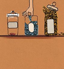 Mano que alcanza para comprar caramelos en jar Foto de stock
