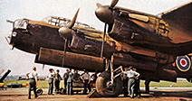 Loading a Lancaster Bomber, 1942 colour photo of the iconic RAF heavy bomber bombing up before a raid on Germany - Stock Photo
