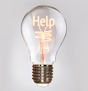 Self Help concept in a filament lightbulb. - Stock Image