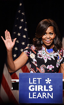 US First Lady Michelle Obama gives a speech at Mulberry School for Girls in East London - Stock Photo