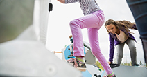 Kids climbing geometric shapes at playground - Stock Photo