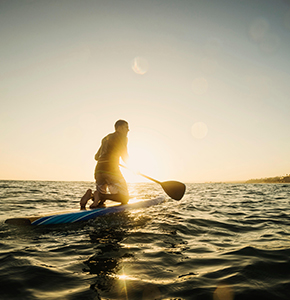 Caucasian man on paddle board in ocean - Stock Photo