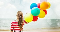 Woman with colorful Balloons on the beach,Outdoors lifestyle filters image Stock Photo