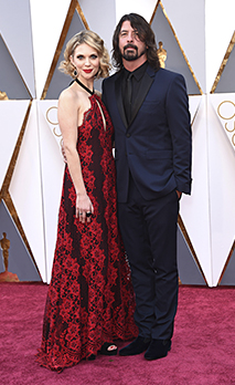 Hollywood, California, USA. 28th Feb, 2016. Singer DAVE GROHL and wife JORDYN BLUM arrive on the red carpet of the - Stock Photo