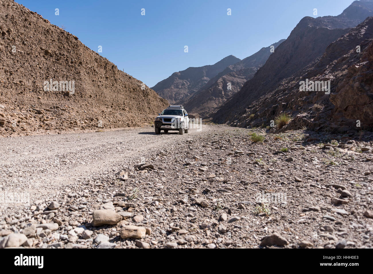 4x4-vehicle-in-a-wadi-dry-riverbed-of-fu