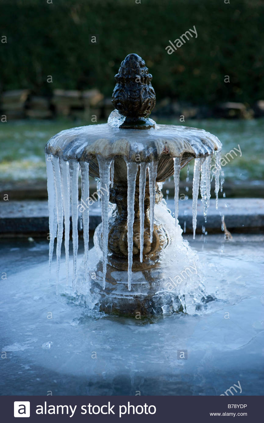 icicles-on-a-fountain-in-a-garden-pond-B